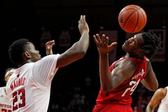 Nebraska forward Yvan Ouedraogo (24) battles for a rebound with Rutgers guard Montez Mathis (23)