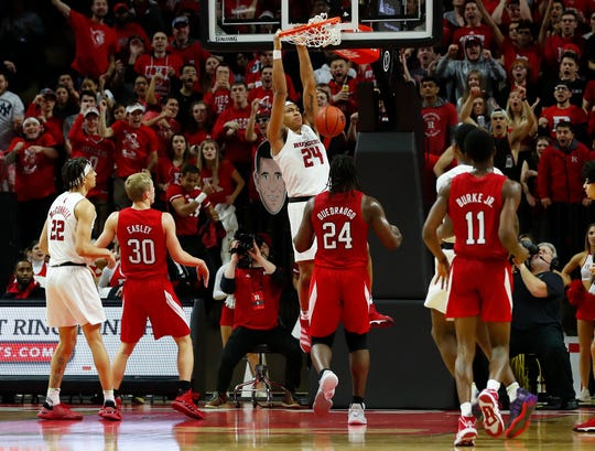 Rutgers Scarlet Knights guard Ron Harper Jr. (24) dunks against the Nebraska Cornhuskers