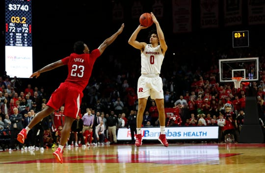 Rutgers Scarlet Knights guard Geo Baker (0) makes the game winning shot against Nebraska Cornhuskers guard Jervay Green (23)