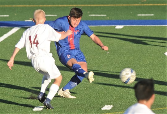 Cooper's Jose Ortega scores his first of two goals for a 2-0 lead with 32:10 left in the first half as Caleb Nelson (14) defends. Cooper won the nondistrict game 12-0 Friday, Jan. 24, 2020, at Shotwell Stadium.