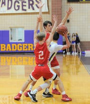 Jim Ned defenders Ben Eschelman, background, and Cy Noland (2) pressure Merkel's Tryce Pape during a District 5-3A game Friday, Jan. 24, 2020, at Merkel High School.