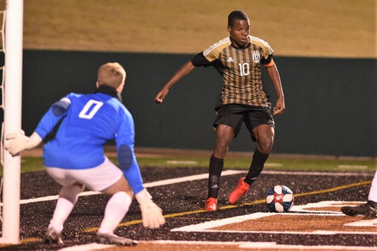 Abilene High's Bernard Kamungo (10) makes a play along the end line against Odessa Permian on Friday at Shotwell Stadium. Kamungo scored two of the Eagles' four goals in the second half to win 5-3.