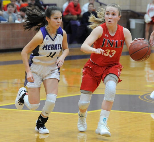 Jim Ned point guard Brooke Galvin (33) dribbles against Merkel on Jan. 24 at Merkel High School.