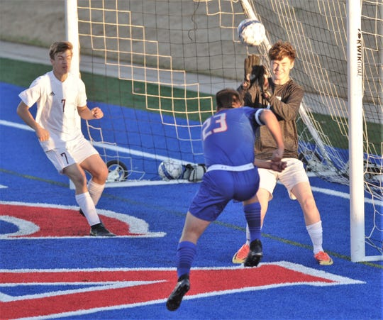 Cooper's Isiah Arratia (23) scores his third goal as the ball gets past Brownwood goalie Tanner Roberts in the first half. Cooper won the nondistrict game 12-0 Friday, Jan. 24, 2020, at Shotwell Stadium.
