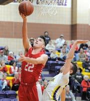 Jim Ned senior Cade Ford goes for a layup against Merkel in a District 5-3A game Friday, Jan. 24, 2020, at Merkel High School.