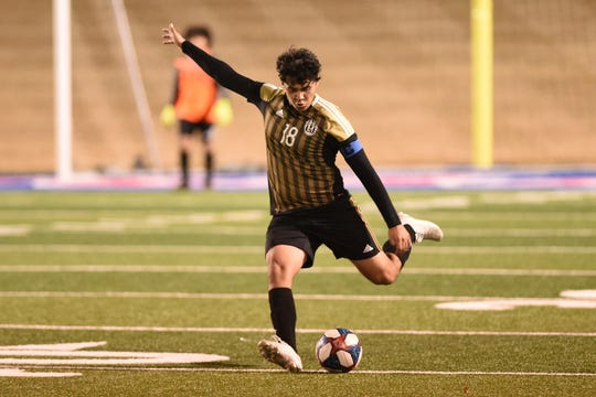 Abilene High's Brandon Segura (18) delivers a free kick against Odessa Permian at Shotwell Stadium on Friday. Segura assisted on the opening goal as the Eagles came back to win 5-3.