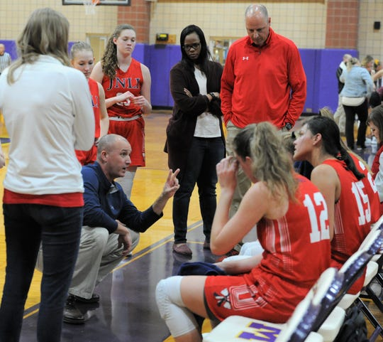 Jim Ned girls basketball coach Hunter Cooley talks to his team during a timeout in a game against Merkel on Friday, Jan. 24, 2020, at Merkel High School.