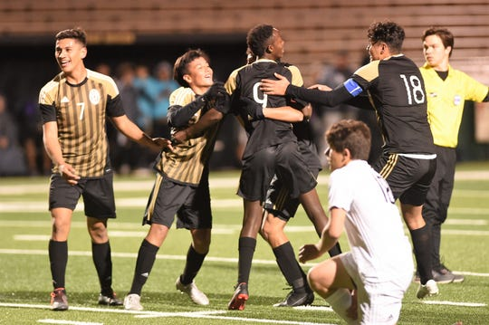 Abilene High's Olivier Murego (9) is congratulated by teammates after scoring a goal against Odessa Permian Jan. 24  at Shotwell Stadium. Murego scored and had an assist in the Eagles 5-3 comeback win in the nondistrict game.