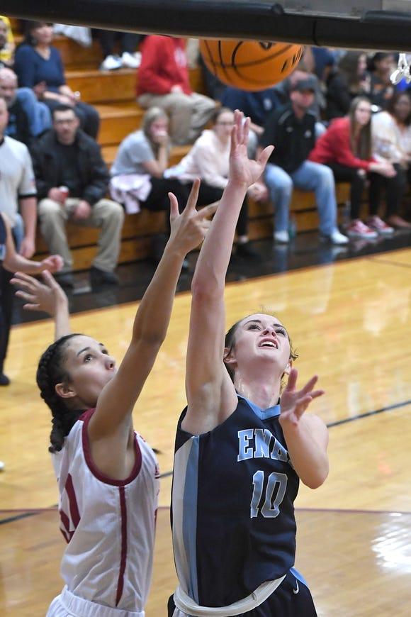 Enka's Emily Carver goes up for a shot against Asheville's Porsha Carter during their game at Asheville High School on Jan. 24, 2020.