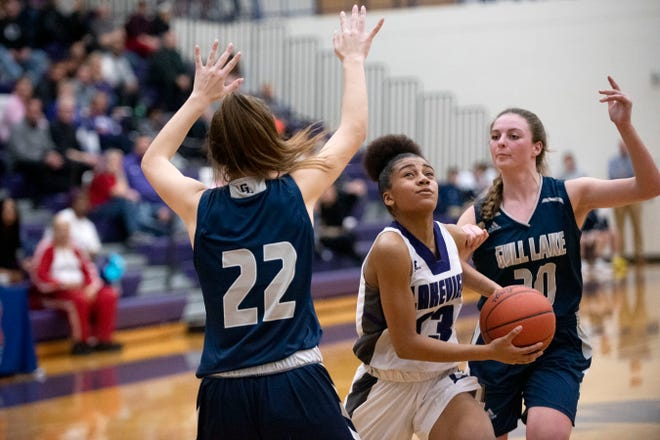 Lakeview junior Brazyll Watkins (13) attempts a basket as Gull Lake sophomore Mackenzie Ford (22) guards her on Friday, Jan. 24, 2020 at Lakeview High School in Battle Creek, Mich.