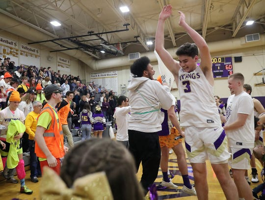 North Kitsap's Aiden Olmstead celebrates with fans after the win over Port Angeles in Poulsbo on Friday, Jan. 24, 2020.