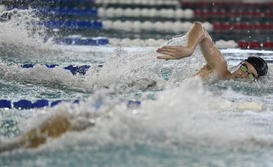Flour Bluff's Kraig Bray competes in the boys 100 yard freestyle at the District 30-5A swim meet, Saturday, Jan. 25, 2020, at the CCISD Natatorium. Schools in the area competed in the meet.