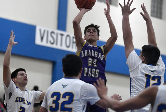 Aransas Pass' Christian Leal, center, shoots the ball against Odem in a District 29-3A basketball game, Friday, Jan. 24, 2020, at Odem High School. Aransas Pass won, 80-49.