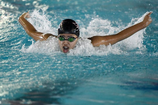 Flour Bluff's Jennifer Pena swims in the girls 100 yard butterfly at the District 30-5A swim meet, Saturday, Jan. 25, 2020, at the CCISD Natatorium. Pena placed first with a 56.34 time.