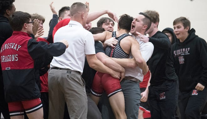 Kingsway's Joey Miranda, center, celebrates with his teammates and coaches after Miranda defeated St. Augustine's Cooper Lange, 17-2, in the 126 lb. bout of the wrestling match held at Kingsway High School on Friday, January 24, 2020.  Kingsway beat St. Augustine, 29-28.