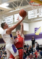 Unioto's Isaac Little takes it to the hoop to score for Unioto in Chillicothe, Ohio, on Jan. 24, 2020. Little scored 15 points for the night to help the Shermans overtake the Redstreaks 45-40 and stay atop the SVC.