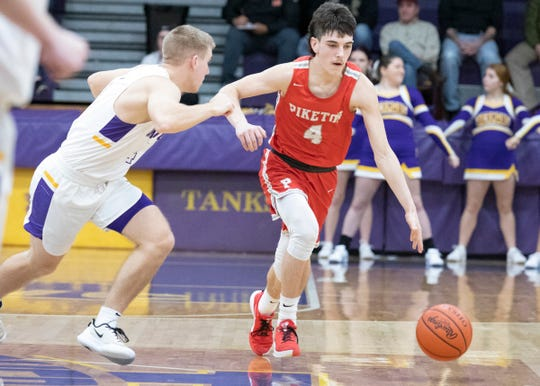 Piketon's Brody Fuller attempts to drive the ball past Unioto in Chillicothe, Ohio, on Jan. 24, 2020. Fuller scored 11 out of Piketon's 40 total points.
