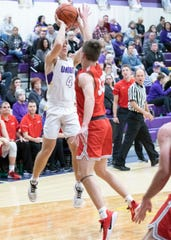 Unioto's Nate Keiser makes a jump shot over Piketon to score for Unioto in Chillicothe, Ohio, on Jan. 24, 2020. Keiser scored 17 out of Unioto's 45 points and helped lead the Shermans to victory over the Redstreaks.