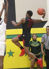 Hughes guard Cameron McKenzie (12) drives to the basket during Hughes' 85-82 double-overtime win over Taft, Friday, Jan. 24, 2020.