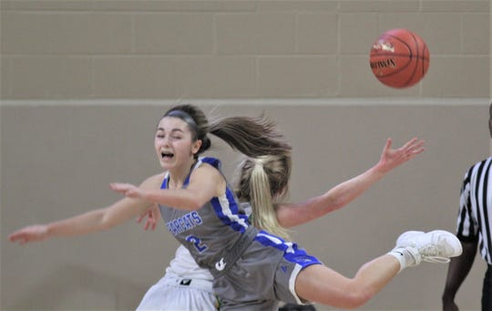 """Walton-Verona junior Haylee Neeley goes to the floor while vying for the ball as Walton-Verona defeated Owensboro Catholic 60-41 in the semifinals of the All """"A"""" Classic state girls basketball tournament Jan. 25, 2020, at Eastern Kentucky University's McBrayer Arena, Richmond, Ky."""