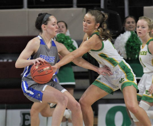 "Walton-Verona senior Emma Strunk faces pressure as Walton-Verona defeated Owensboro Catholic 60-41 in the semifinals of the All ""A"" Classic state girls basketball tournament Jan. 25, 2020, at Eastern Kentucky University's McBrayer Arena, Richmond, Ky."