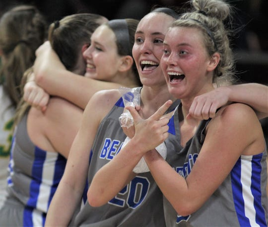 """Walton-Verona players celebrate their win as Walton-Verona defeated Owensboro Catholic 60-41 in the semifinals of the All """"A"""" Classic state girls basketball tournament Jan. 25, 2020, at Eastern Kentucky University's McBrayer Arena, Richmond, Ky."""