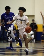 Moeller guard Aidan Turner brings the ball up the court in the boys basketball game between Saint Xavier at Moeller High School Jan. 24, 2020.