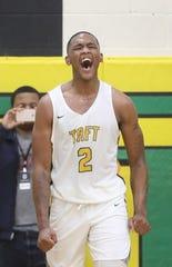Taft forward Nekhi Smith (2) reacts during their basketball game against Hughes, Friday, Jan. 24, 2020.