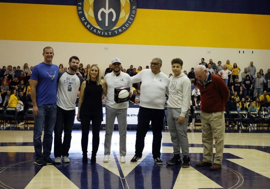The family of Joel Cornette is honored at halftime in the boys basketball game between Saint Xavier at Moeller High School Jan. 24, 2020.