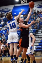 Ridgewood's Kadin Bradford shoots in the lane as Isaac Beaver defends during the Generals' 70-45 win against Buckeye Trail on Friday night in Old Washington.