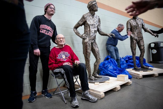 Former Des Moines Register columnist John Karras poses for photos next to a bronze sculpture of himself and late fellow RAGBRAI co-founder Donald Kaul during the Iowa Bike Expo on Saturday, Jan. 25, 2020, at the Iowa Events Center. The statues honoring the two founders and will eventually be installed in Des Moines' Water Works Park.