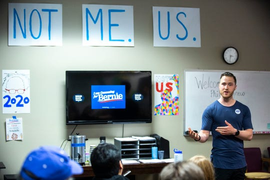 Mike Posner speaks at a canvass launch event before door knocking for U.S. Sen. Bernie Sanders, Friday, Jan. 24, 2020, in Iowa City, Iowa.