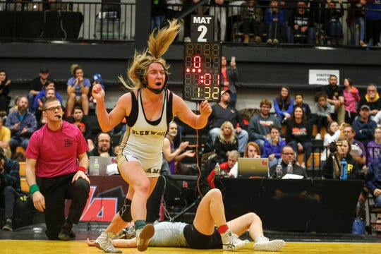 Glenwood senior Abby McIntyre celebrates after pinning Waverly-Shell Rock's Annika Behrends for a state title at 132 pounds during the 2020 Iowa girls state wrestling tournament on Saturday, Jan. 25, 2020, at Waverly-Shell Rock High School.