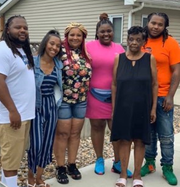 Karyree Henderson, 21, (far right) and Damiko Carr, 28, (far left) shown in an undated family photo. The brothers died after being shot Jan. 15, 2020.