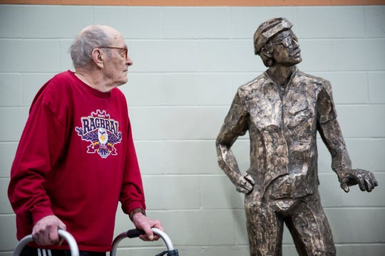 John Karras stands next to a bronze sculpture of late fellow RAGBRAI co-founder Donald Kaul before unveiling one of himself, as well, during the Iowa Bike Expo on Saturday, Jan. 25, 2020, at the Iowa Events Center. The statues honoring the founders will eventually be installed in Des Moines' Water Works Park.