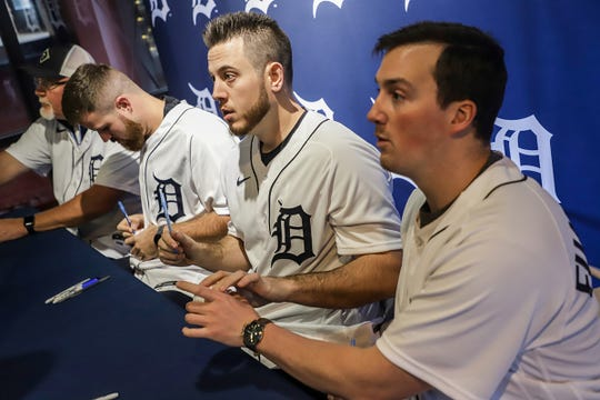 Detroit Tigers' Veteran first baseman C.J. Cron and Right-handed Pitcher Kyle Funkhouser sign autographs and pose for pictures during the Winter Caravan at M Den and Hockeytown Cafe in Detroit on Saturday, Jan. 25, 2020.