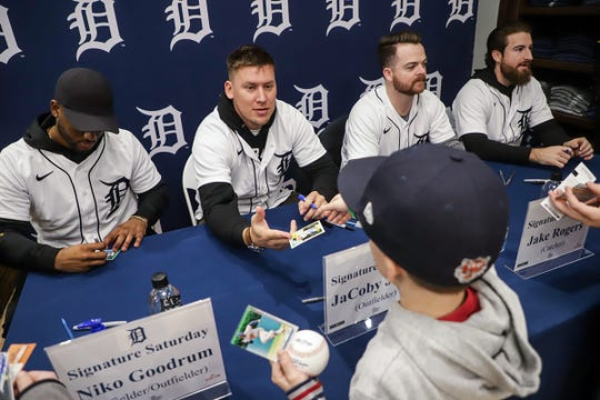 Detroit Tigers' Niko Goodrum, JaCoby Jones, Jake Rogers and Eric Haase sign autographs and pose for pictures during the Winter Caravan at M Den and Hockeytown Cafe in Detroit on Saturday, Jan. 25, 2020.