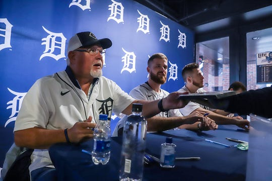 Detroit Tigers' Manager Ron Gardenhire, left, Pitcher Buck Farmer and C.J. Cron sign autographs and pose for pictures during the Winter Caravan at M Den and Hockeytown Cafe in Detroit on Saturday, Jan. 25, 2020.