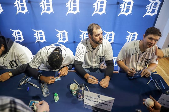 Detroit Tigers' Michael Fulmer and Grayson Greiner sign autographs and pose for pictures during the Winter Caravan at M Den and Hockeytown Cafe in Detroit on Saturday, Jan. 25, 2020.