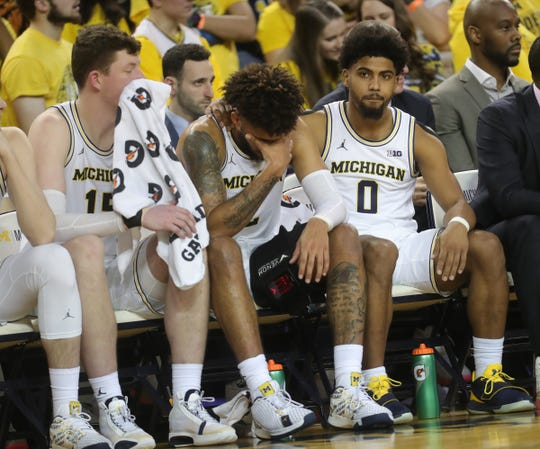 Michigan forward Isaiah Livers (2) is comforted on the bench by teammate David DeJulius (0) after a hard foul during the second half Saturday, Jan. 25, 2020 at the Crisler Center.
