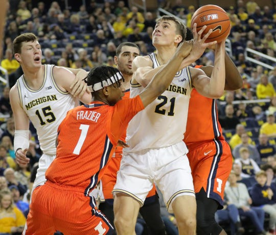 Michigan guard Franz Wagner is defended by Illinois guard Trent Frazier during the first half Saturday, Jan. 25, 2020, at the Crisler Center in Ann Arbor.