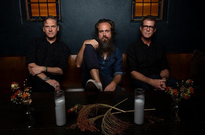 Iron & Wine (aka Samuel Ervin Beam), center, with Calexico's Joey Burns and John Convertino.