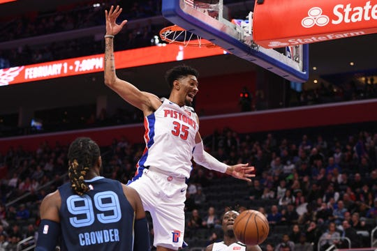 Pistons forward Christian Wood celebrates a dunk during the second quarter against the Grizzlies at Little Caesars Arena, Jan. 24, 2020.