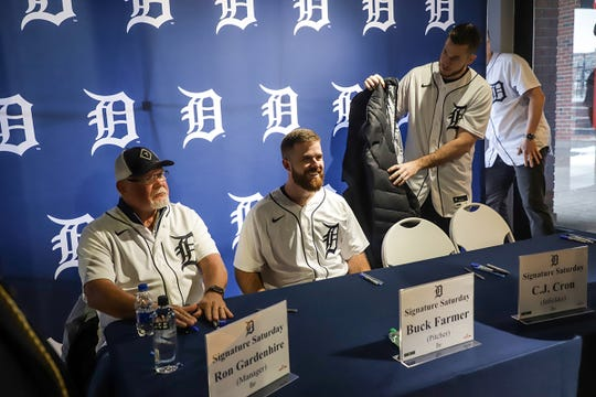 Detroit Tigers' Manager Ron Gardenhire, left, Pitcher Buck Farmer and C.J. Cron sit down to sign autographs and pose for pictures during the Winter Caravan at M Den and Hockeytown Cafe in Detroit on Saturday, Jan. 25, 2020.