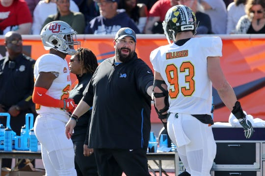 North head coach Matt Patricia of the Detroit Lions talks to defensive lineman Kenny Willekes of Michigan State on the sideline in the first half at Ladd-Peebles Stadium, Jan. 25, 2020 in Mobile, Ala.