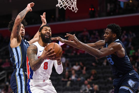 Pistons forward Markieff Morris (8) goes to the basket as Grizzlies forward Brandon Clarke (15) and forward Jaren Jackson Jr. (13) defend at Little Caesars Arena.