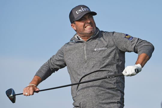 Ryan Palmer reacts after hitting his tee shot on the 18th hole of the North Course Friday at Torrey Pines.