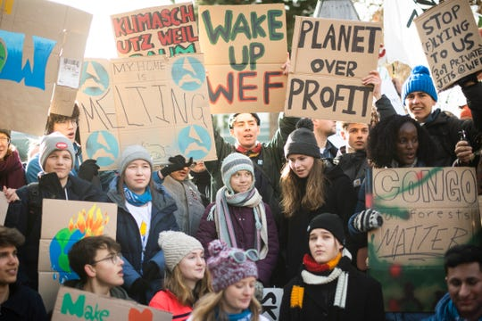"""Swedish climate activist Greta Thunberg, center, is pictured during a """"Fridays for Future"""" demo on the final day of the 50th annual meeting of the World Economic Forum, WEF, in Davos, Switzerland, Friday, Jan. 24, 2020."""
