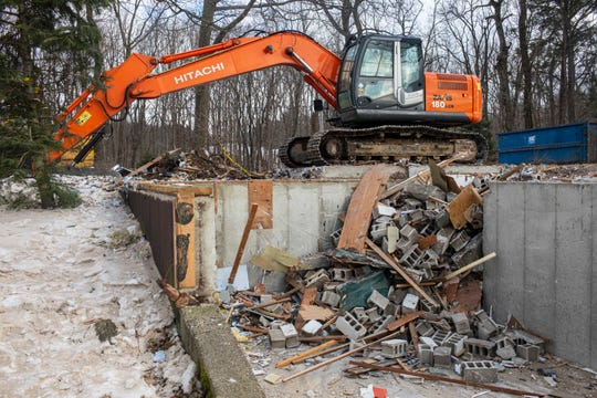 A view of the remains of the home that is being demolished in the 2200 block of Lakeshore Drive in Ganges, Michigan on Tuesday, Jan. 21, 2020.