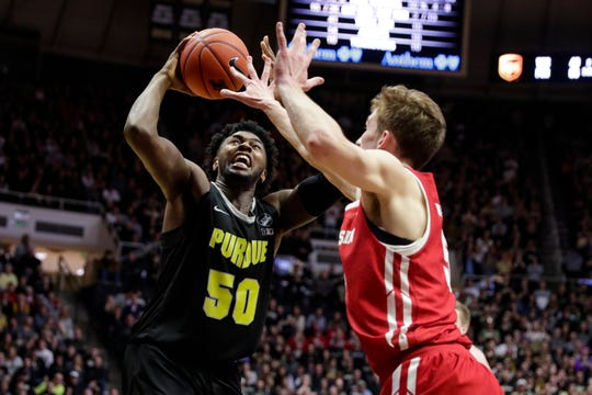 Purdue forward Trevion Williams (50) shoots over Wisconsin forward Tyler Wahl (5) during the second half.